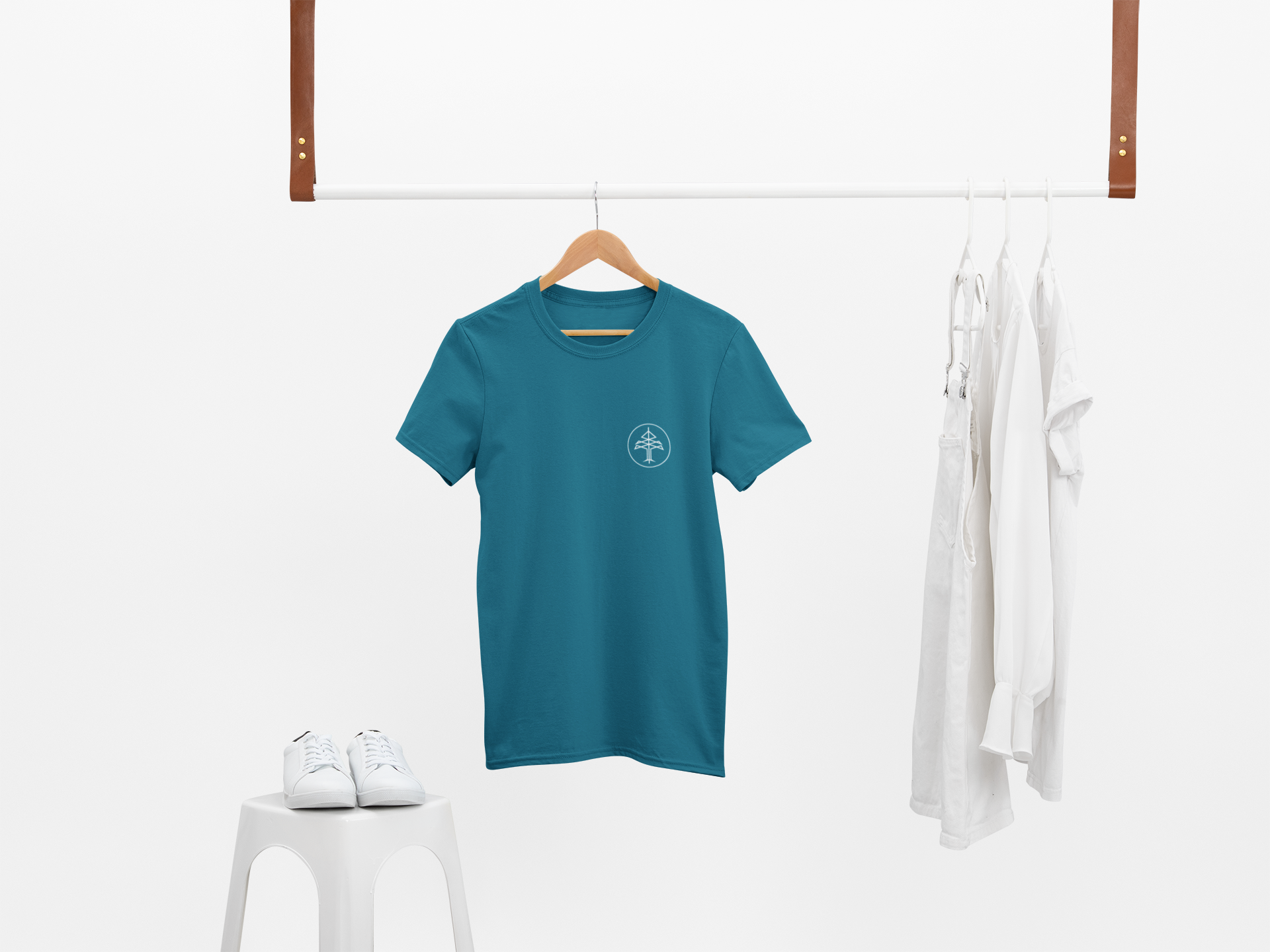 Mockup of a t shirt hanging with only white clothes 26889